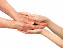 Children's hands embrace old hands Stock Photography