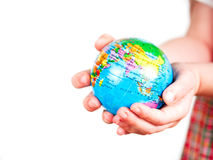 Hands of a child holding a globe Royalty Free Stock Photos