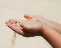 Hands of the child holding sand Royalty Free Stock Photography