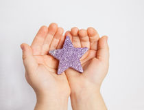 Hands of a child holding small star Royalty Free Stock Image