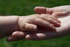 Hands of child and mother Royalty Free Stock Photo