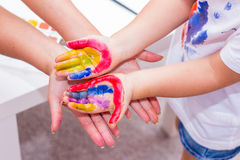 Hands of a child painted with bright colors. Royalty Free Stock Photography