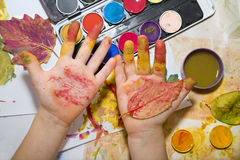 Hands of child by the painting Stock Photo