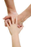 Hands the child and parents Stock Photo