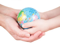 Hands of a child and a woman holding globe Royalty Free Stock Photos