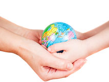 Hands of a child and a woman holding globe Stock Photo