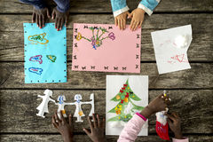 Hands of children drawing and making crafts Stock Photo