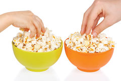 Hands of children eating popcorn Stock Photography