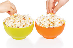Hands of children eating popcorn Stock Image