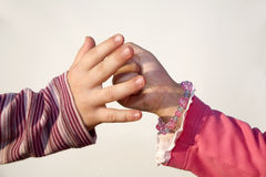 Hands of children by game Stock Photography