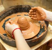 The hands of children learning pottery. In the pottery workshop. The hands of children learning pottery Royalty Free Stock Photo