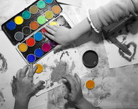 Hands of children by painting Stock Image