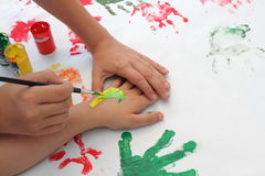 Hands of children painting. Children's hands painting with watercolors Royalty Free Stock Image