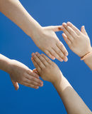 Hands of children and the sky Royalty Free Stock Images