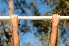 Hands on chin-up bars. A set of chin-up bars at boot-camp on Parris Island royalty free stock image