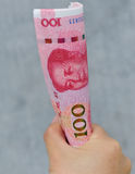 Hands with chinese yuan money Stock Image