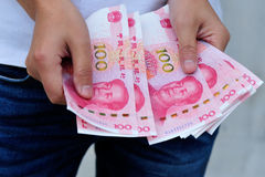 Hands with chinese yuan money Stock Photos