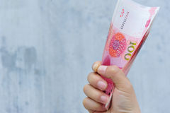 Hands with chinese yuan money Royalty Free Stock Photo