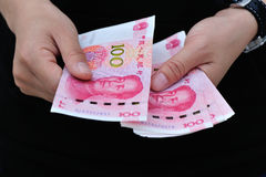 Hands with chinese yuan money Royalty Free Stock Image