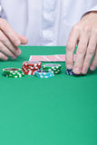 Hands, chips, cards, game table Stock Photography