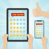 Hands choosing five stars rating on gadgets Royalty Free Stock Photography
