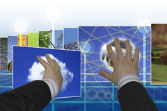 Hands choosing images on touchscreen interface Royalty Free Stock Photo
