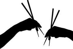 Hands with chopstick Stock Photos