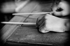 Hands and chopsticks. Hands holding a pair of chopsticks, thailand Royalty Free Stock Photos