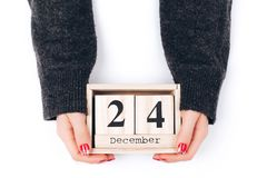 Hands with Christmas Eve date. Woman`s hands holding calendar with Christmas Eve date Royalty Free Stock Images