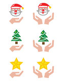 Hands with Christmas icons - Santa Claus, tree, star Stock Image