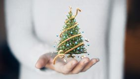 Christmas tree on hand, decorations, gift card Royalty Free Stock Photography