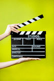 Hands with clapperboard. On a green background Royalty Free Stock Photography