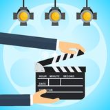 Hands with clapperboard poster Royalty Free Stock Image