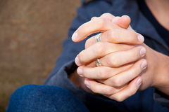 Hands Clasped. A man's hands are locked together with rings and knuckles Royalty Free Stock Photo