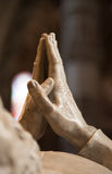 Hands clasped. Detail of a marble monument depicting the hands clasped in prayer Stock Photo