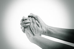 Hands clasped hands with hope isolated on white background stock photos