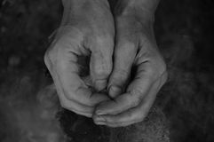 Hands clasped together. Adult man, smoke, log background stock images