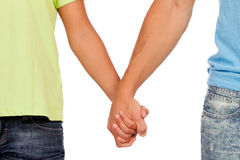 Hands clasped of two male lovers Royalty Free Stock Photo