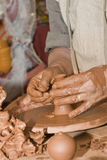 Hands and clay. Stock Photo