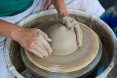 Hands in clay making a pot Stock Photography