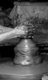 Hands on clay. Pottery is one of the oldest human inventions, originating before the Neolithic period, with ceramic objects like the Gravettian culture Venus of Royalty Free Stock Images