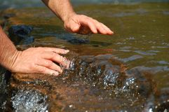 Hands in Clean Running Water of Stream Royalty Free Stock Photo
