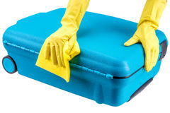 Hands clean suitcase Stock Photography