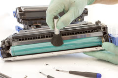 Hands cleaning toner cartridge stock images