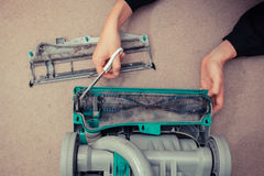 Hands cleaning vacuum cleaner Stock Image