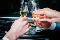 Hands clink glasses with champagne Royalty Free Stock Photo