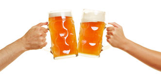Hands clinking beer glasses Stock Images