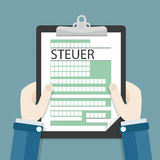 Hands Clipboard Steuer. German text Steuer, translate Tax Stock Image