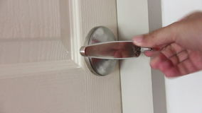 Hands Close House Door And Lock stock footage