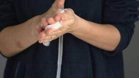Hands close up cleaning with antibacterial wipes. Covid19 spread prevention